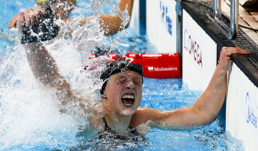 Katie Ledecky of the U.S. celebrates after setting a new world record and winning the women's 800m freestyle final at the Aquatics World Championships in Kazan, Russia, August 8, 2015.                    REUTERS/Michael Dalder TPX IMAGES OF THE DAY - RTX1NLHV