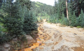 Yellow mine waste water from the Gold King Mine is seen in San Juan County, Colorado, in this picture released by the Environmental Protection Agency (EPA) taken August 7, 2015.  A contaminated plume of waste water accidentally released from a Colorado gold mine by U.S. environmental agency workers has spread downstream and reached northern New Mexico, officials said on Saturday.  Picture taken August 7, 2015. REUTERS/EPA/Handout THIS IMAGE HAS BEEN SUPPLIED BY A THIRD PARTY. IT IS DISTRIBUTED, EXACTLY AS RECEIVED BY REUTERS, AS A SERVICE TO CLIENTS. FOR EDITORIAL USE ONLY. NOT FOR SALE FOR MARKETING OR ADVERTISING CAMPAIGNS - RTX1NP0M