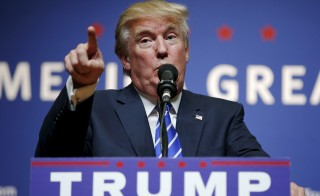 U.S. Republican presidential candidate Donald Trump speaks at a campaign rally in Hampton, New Hampshire, August 14, 2015. Trump's foreign policy platform would put troops on the ground in the fight against the Islamic State, and demand money from Middle Eastern countries supported by the U.S. Brian Snyder/Reuters