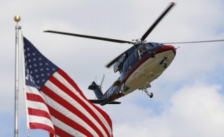U.S. Republican presidential candidate Donald Trump's helicopter lands in a field before his visit to the Iowa State Fair during a campaign stop in Des Moines, Iowa, United States, August 15, 2015. Photo by Jim Young/Reuters
