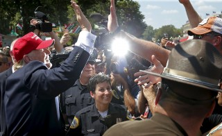 U.S. Republican presidential candidate Donald Trump greets attendees at the Iowa State Fair during a campaign stop in Des Moines, Iowa, United States, August 15, 2015.  REUTERS/Jim Young   - RTX1ODW2