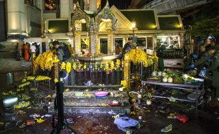 Experts investigate at the Erawan shrine, the site of a deadly blast in central Bangkok. A bomb on a motorcycle exploded on Monday just outside a Hindu shrine in the Thai capital, killing several people, including foreign tourists, media reported. Photo by Athit Perawongmetha/Reuters