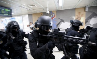 Members of the Special Weapon and Tactics (SWAT) team take part in an anti-terror drill in Seoul, South Korea, on Aug. 19, 2015. South Korea on Wednesday staged a nationwide civil defense drill, called the annual Ulchi Exercise, where they hope to prepare the general public for all possible emergencies. The Ulchi Exercise is run in parallel with the annual Ulchi Freedom Guardian exercise, where both South Korean and U.S. forces also hold joint military drills. Photo by Kim Hong-Ji/Reuters