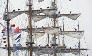 Sailors stand on the mast of the Guayas, a tall ship from Ecuador, during the Sail-In Parade marking the beginning of the Sail Amsterdam 2015 nautical festival on August 19, 2015. Photo by Paul Vreeker/Reuters