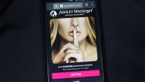 A photo illustration shows the Ashley Madison website displayed on a smartphone in Toronto, August 20, 2015. Love lives and reputations may be at risk after the release of customer data from infidelity website Ashley Madison, an unprecedented breach of privacy likely to rattle users' attitudes towards the Internet. Hackers dumped a big cache of data containing millions of email addresses for U.S. government officials, UK civil servants and high-level executives at European and North America corporations late on Tuesday, the latest cyber attack to raise concerns about Internet security and data protection.   REUTERS/Mark Blinch  - RTX1OZ5D