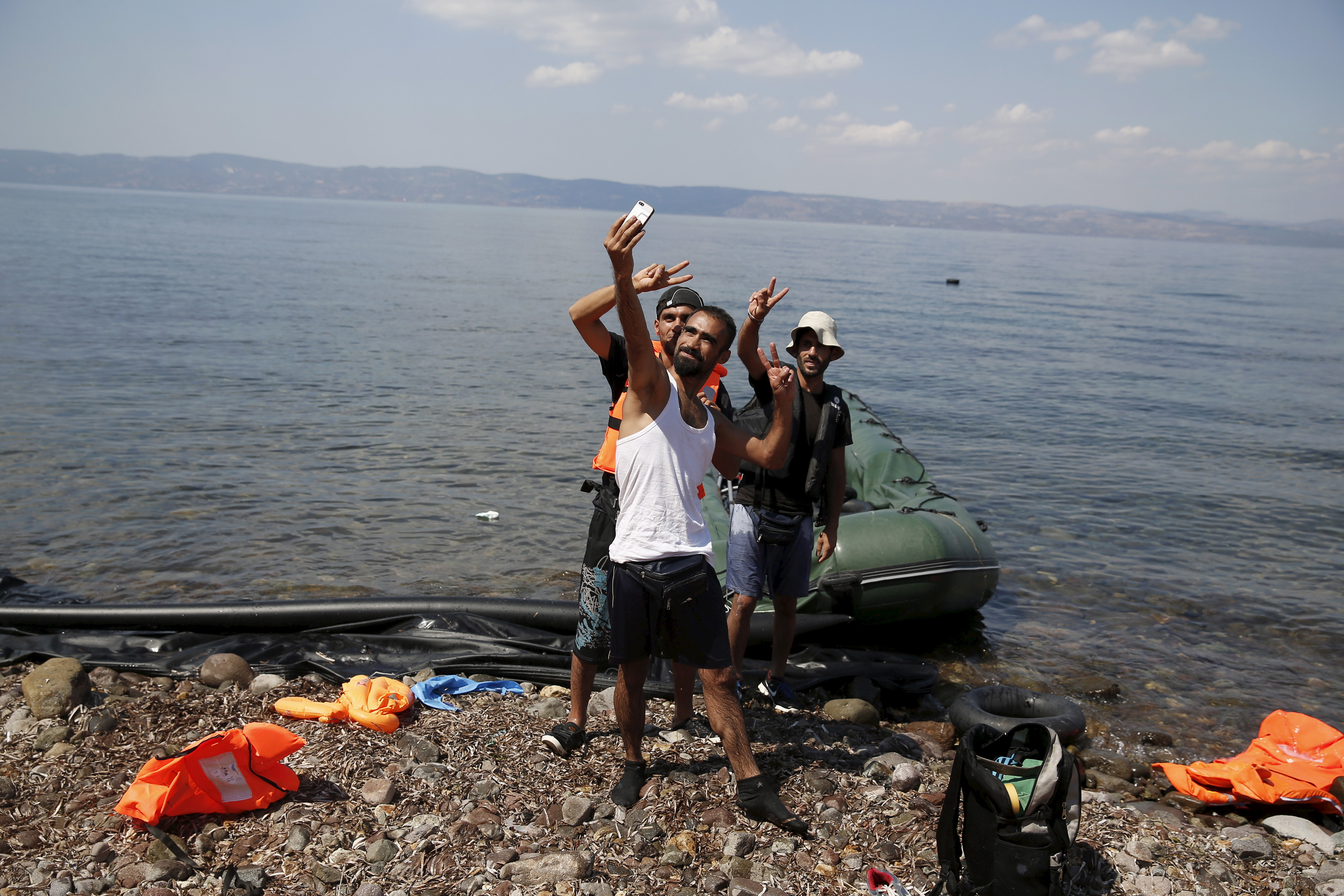 Syrian refugees from Kobani pose for a selfie, moments after arriving on a dinghy on the island of Lesbos, Greece August 23, 2015. Photo by Alkis Konstantinidis/Reuters.