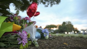 Flowers are seen at a memorial outside of the offices for WDBJ7 where slain journalists Alison Parker and Adam Ward worked in Roanoke, Virginia August 27, 2015. Parker, 24, and Ward, 27, were shot dead on Wednesday during a live segment for the CBS affiliate in Roanoke, Virginia, at a local recreation site about 200 miles (320 km) southwest of Washington. Another woman was wounded. The suspected gunman, 41-year-old Vester Flanagan, later died from a self-inflicted gunshot wound, authorities said. REUTERS/Chris Keane - RTX1PVGV