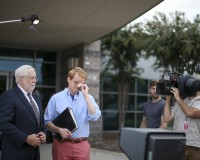 Chris Hurst (R), a journalist at the station and boyfriend of slain journalist Alison Parker, pauses for a moment as Jeff Marks (L), general manager for WDBJ7, looks on while they speak with NBC's Today Show outside of the offices for WDBJ7, where slain journalists Parker and Adam Ward worked in Roanoke, Virginia August 27, 2015. Parker, 24, and Ward, 27, were shot dead on Wednesday during a live segment for the CBS affiliate in Roanoke, Virginia, at a local recreation site about 200 miles (320 km) southwest of Washington. Another woman was wounded. The suspected gunman, 41-year-old Vester Flanagan, later died from a self-inflicted gunshot wound, authorities said. REUTERS/Chris Keane - RTX1PVIO