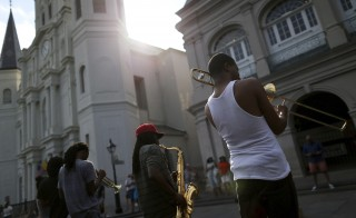 A brass band performs in Jackson Square one day before the ten year anniversary of Hurricane Katrina in New Orleans, Louisiana, August 28, 2015. REUTERS/Jonathan Bachman - RTX1Q4A9
