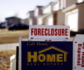 """Foreclosure: The sign for a foreclosed house for sale sits at the property in Denver, Colorado March 4, 2009. The Obama administration on Wednesday launched a $75 billion foreclosure relief plan, as new data showed one in five U.S. homeowners with mortgages owe more than their house is worth. The mortgage plan, part of a $275 billion housing stimulus program announced last month, enables struggling homeowners to modify loans even if they are """"under water.""""  REUTERS/Rick Wilking (UNITED STATES) - RTXCCXK"""