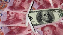 A U.S. $100 banknote is placed next to 100 yuan banknotes in this picture illustration taken in Beijing October 16, 2010. The United States fired the first shot in the currency war and the rest of the world must be on guard for its deliberate strategy to devalue the dollar, a Chinese economist said in an official newspaper on Thursday. REUTERS/Petar Kujundzic (CHINA - Tags: BUSINESS IMAGES OF THE DAY) - RTXTHH0