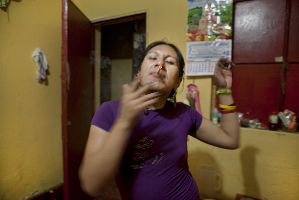 Tamara smokes a cigarette while dancing in her room.