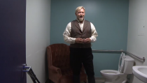"Jay Hunter Morris warms up in the bathroom before a performance of ""Cold Mountain."""
