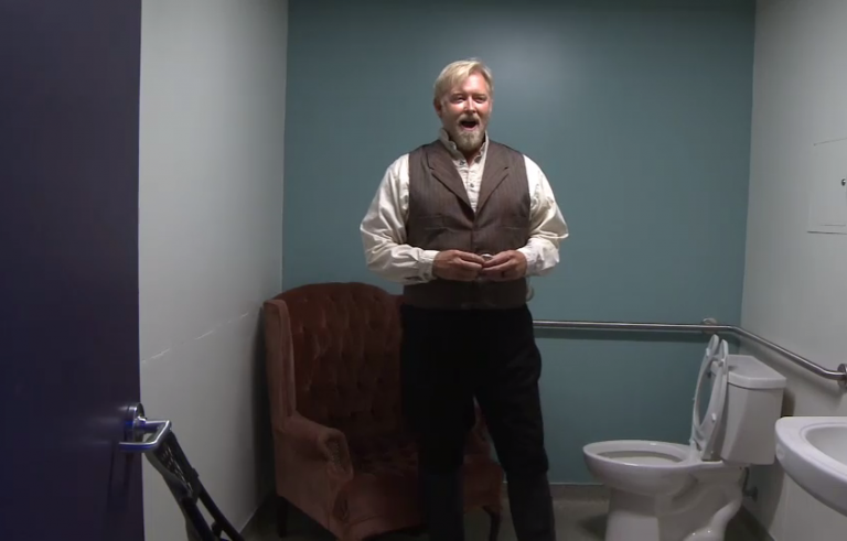 """Jay Hunter Morris warms up in the bathroom before a performance of """"Cold Mountain."""""""