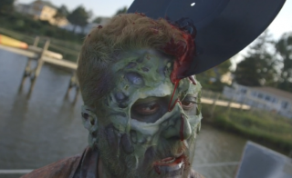 The NewsHour's Mike Melia in zombie makeup on the set of Sam and Mattie's zombie movie.