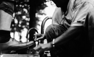 Eddie, a Vietnam vet, shines shoes on Georgia Ave. in Washington, D.C. Photo by Tia Thompson