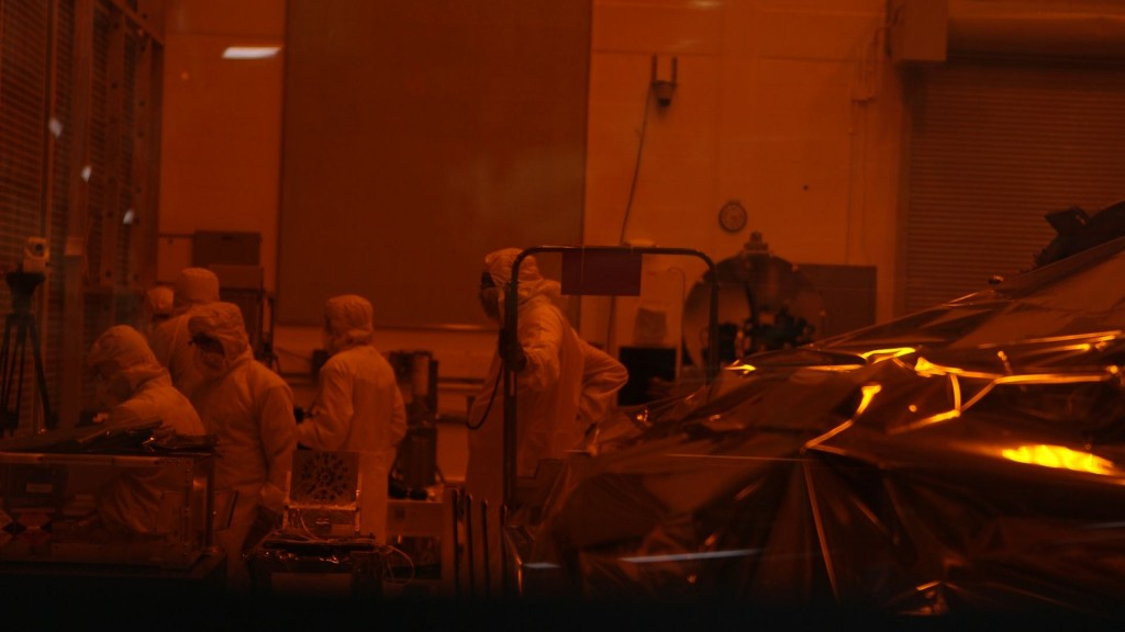 Scientist work on ICESat-2 in clean room at NASA Goddard Space Flight Center. Photo by Mike Fritz