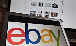 The ebay Inc. logo and website are arranged for a photograph in Tiskilwa, Illinois, U.S., on Tuesday, Jan. 20, 2015. Ebay Inc. is scheduled to release earnings figures after the close of U.S. financial markets on Jan. 21. Photo by Daniel Acker/Bloomberg via Getty Images