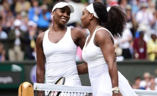 LONDON, ENGLAND - JULY 06: Venus Williams (L) and Serena Williams (R) of the United States react after their match during day eight of the Wimbledon Lawn Tennis Championships at the All England Lawn Tennis and Croquet Club on July 06, 2015 in London, England. (Photo by Alex Broadway/Anadolu Agency/Getty Images)