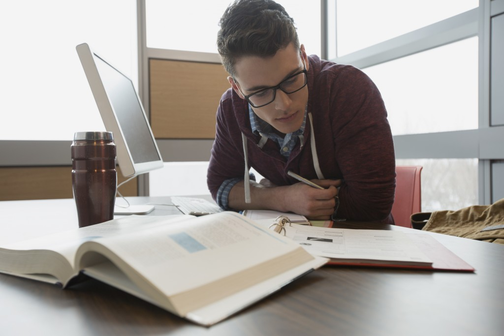 A college student studying. A new survey finds that millennials are actually more informed than most people would think.