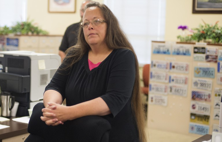 Kim Davis, the Rowan County Clerk of Courts, listens to Robbie Blankenship and Jesse Cruz as they speak with her at the County Clerks Office on September 2, 2015 in Morehead, Kentucky. Citing a sincere religious objection, Davis, an Apostolic Christian, has refused to issue marriage licenses to same sex couples in defiance of a Supreme Court ruling. (Photo by Ty Wright/Getty Images)