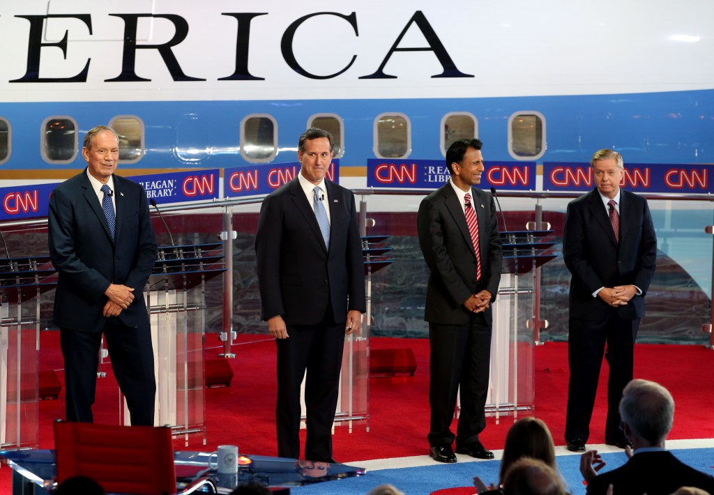 Republican presidential candidates George Pataki, Rick Santorum, Bobby Jindal and Lindsey Graham stand onstage during the Republican presidential debates at the Reagan Library in Simi Valley on September 16, 2015.  Photo by Justin Sullivan/Getty Images