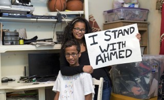 Ahmed Mohamed, a Texas Muslim teen arrested after taking his homemade clock to school, poses with his sister at their house in Irving, Texas. Photo by Bilgin S. Sasmaz/Anadolu Agency/Getty Images
