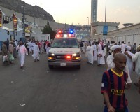 MECCA, SAUDI ARABIA - SEPTEMBER 24: Ambulances are seen on a road after at least 753 Muslim Hajj pilgrims were killed  and at least another 450 injured  in a stampede that took place near the city of Mecca in Saudi Arabia on September 24, 2015. The stampede occurred in the town of Mina, located roughly five kilometers east of Mecca, as pilgrims performed a ritual in which they threw stones at a structure representing the devil. (Photo by Ozkan Bilgin/Anadolu Agency/Getty Images)