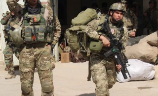 Afghan special forces arrive at the airport as they launch a counteroffensive to retake the city from Taliban insurgents, in Kunduz on Septmber 29, 2015. The Afghan army on September 29 launched a counter-offensive to retake Kunduz from the Taliban, a day after insurgents overran the strategic northern city.   AFP PHOTO / Nasir Waqif        (Photo credit should read NASIR WAQIF/AFP/Getty Images)
