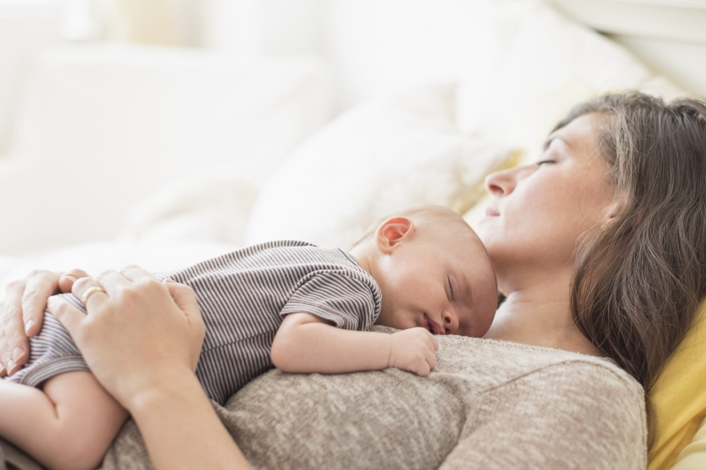 USA, New Jersey, Jersey City, Mother with baby boy (2-5 months ) taking nap together. Photo by Tetra Images/Getty Images
