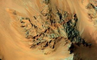 This image shows the central mountains of Hale Crater on Mars, one for four locations on the planet where scientists confirmed today the existence of flowing saltwater rivers called recurring slope lineae (RSL). These active flows are seasonal and extend downhill from bedrock cliffs, mostly towards the northwest (upper left). This image was acquired in middle summer when RSL are most active in the southern mid latitudes. Photo by NASA/JPL-Caltech/University of Arizona