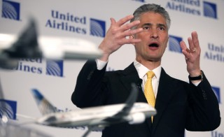 Jeff Smisek, Chairman, President and Chief Executive Officer of Continental speaks during a news conference announcing the merger between Continental and United Airlines in New York, May 3, 2010. United Airlines parent UAL Corp will buy Continental Airlines Inc for $3.17 billion to form the world's largest carrier, moving to better withstand the hazards that have battered airlines in recent years. REUTERS/Shannon Stapleton (UNITED STATES - Tags: TRANSPORT BUSINESS) - RTR2DEWD