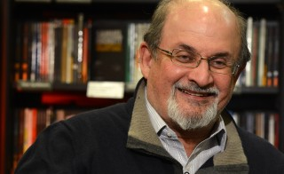 "Author Salman Rushdie gestures during an interview with Reuters in central London, September 28, 2012.  Rushdie, best known for his Booker Prize-winning 1981 novel ""Midnight's Children"", has written a 633-page account of his time under police protection in Britain, telling in detail what it was like to live in the eye of a storm.  REUTERS/Paul Hackett  (BRITAIN - Tags: ENTERTAINMENT PROFILE) - RTR38JV9"