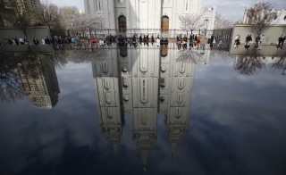 People walk past Salt Lake temple as they arrive to attend the biannual general conference of the Church of Jesus Christ of Latter-day Saints in Salt Lake City, Utah April 5, 2014. Photo by Jim Urquhart/Reuters