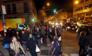 People walk to higher ground for safety, in Valparaiso city Thursday after a mass evacuation of the entire coastline during a tsunami alert after a magnitude 8.3 earthquake hit off the coast of Chile on Wednesday night. Photo by Rodrigo Garrido/Reuters