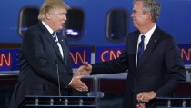 Republican U.S. presidential candidates businessman Donald Trump (L) and former Florida Governor Jeb Bush shake hands during a commercial break at the second official Republican presidential candidates debate of the 2016 U.S. presidential campaign at the Ronald Reagan Presidential Library in Simi Valley, California, United States, September 16, 2015. REUTERS/Lucy Nicholson - RTS1HL5