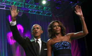 U.S. President Barack Obama and First Lady Michelle Obama greet the Congressional Black Caucus Foundation's 45th Annual Legislative Conference Phoenix Awards Dinner in Washington September 19, 2015. REUTERS/Yuri Gripas - RTS1XVG