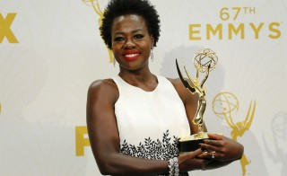 "Actress Viola Davis holds the award for Outstanding Lead Actress In A Drama Series for her role in ABC's ""How To Get Away With Murder"" during the 67th Primetime Emmy Awards in Los Angeles, California. REUTERS/Mike Blake -"