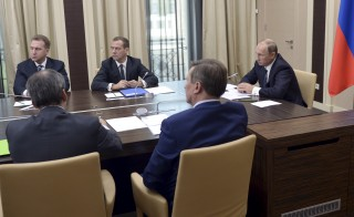 Russian President Vladimir Putin (R) chairs a meeting with members of the government at the Novo-Ogaryovo state residence outside Moscow, Russia, September 30, 2015. Putin said on Wednesday the only way to fight terrorists in Syria was to act preemptively, saying Russia's military involvement in the Middle East would only involve its air force and only be temporary. REUTERS/Alexei Nikolsky/RIA Novosti/Kremlin ATTENTION EDITORS - THIS IMAGE HAS BEEN SUPPLIED BY A THIRD PARTY. IT IS DISTRIBUTED, EXACTLY AS RECEIVED BY REUTERS, AS A SERVICE TO CLIENTS.      TPX IMAGES OF THE DAY      - RTS2FBB