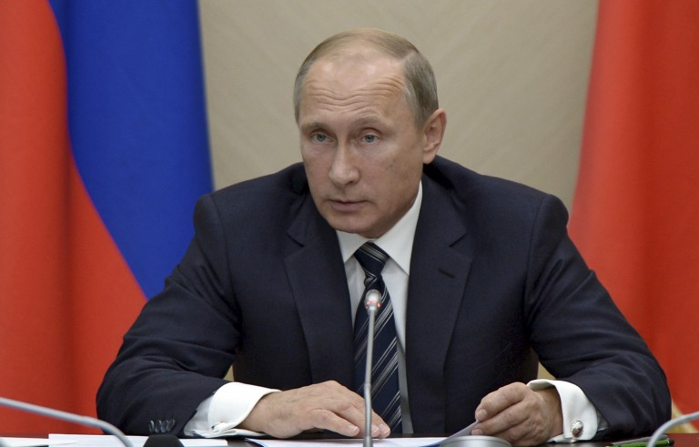Russian President Vladimir Putin chairs a meeting with members of the government at the Novo-Ogaryovo state residence outside Moscow, Russia, September 30, 2015. Putin said on Wednesday the only way to fight terrorists in Syria was to act preemptively, saying Russia's military involvement in the Middle East would only involve its air force and only be temporary. REUTERS/Alexei Nikolsky/RIA Novosti/Kremlin ATTENTION EDITORS - THIS IMAGE HAS BEEN SUPPLIED BY A THIRD PARTY. IT IS DISTRIBUTED, EXACTLY AS RECEIVED BY REUTERS, AS A SERVICE TO CLIENTS. - RTS2G3T
