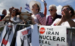 People cheer at the start of a Tea Party rally against the Iran nuclear deal at the U.S. Capitol on Wednesday. Today, senate Democrats voted to uphold the hard-fought nuclear accord with Iran. Photo by Jonathan Ernst/Reuters