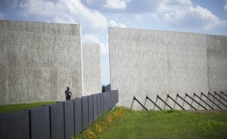 A United States Park Ranger walks through the newly opened Flight 93 Memorial in Shanksville, Pennsylvania, September 9, 2015. The new $50 million visitors center at the heart of a national memorial created out of the crash site will be formally dedicated on Thursday, a day before ceremonies mark the fourteenth anniversary of the worst terrorist attack on American soil.  On September 11, 2001, one of the four planes overtaken by al Qaeda terrorists crashed into Pennsylvania, killing all 40 passengers aboard.  A 9-11 memorial ceremony will take place on Friday. To match story USA-SEPT11/SHANKSVILLE    REUTERS/Mark Makela - RTSE6E