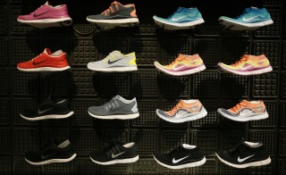 Shoes are displayed at the Nike store in Santa Monica, California, September 25, 2013. NIKE, Inc. plans to release its first quarter fiscal 2014 financial results on Thursday, September 26, 2013.  REUTERS/Lucy Nicholson (UNITED STATES - Tags: BUSINESS SPORT) - RTX13ZXV