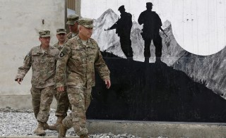 U.S. General John Campbell, commander of international forces in Afghanistan, arrives for a change of command ceremony for the 438th Train, Advise, Assist Command-Air (TAAC-Air) at Oqab base, in Kabul, Afghanistan, July 27, 2015. REUTERS/Omar Sobhani - RTX1LXBO