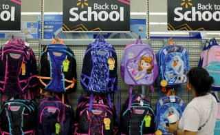 A woman shops for back to school supplies at a Walmart store in San Diego, California August 6, 2015.      REUTERS/Mike Blake - RTX1NDM1