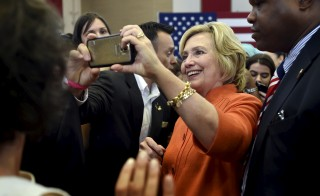Democratic presidential candidate Hillary Clinton takes a photo with a supporter after speaking at a town hall meeting in Las Vegas, Nevada August 18, 2015. REUTERS/David Becker - RTX1OPHZ