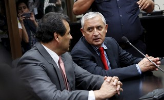 Guatemala's President Otto Perez Molina (right) speaks with his lawyer after his arrival at the Supreme Court of Justice in Guatemala City on Sept. 3. Photo by Jorge Dan Lopez/Reuters