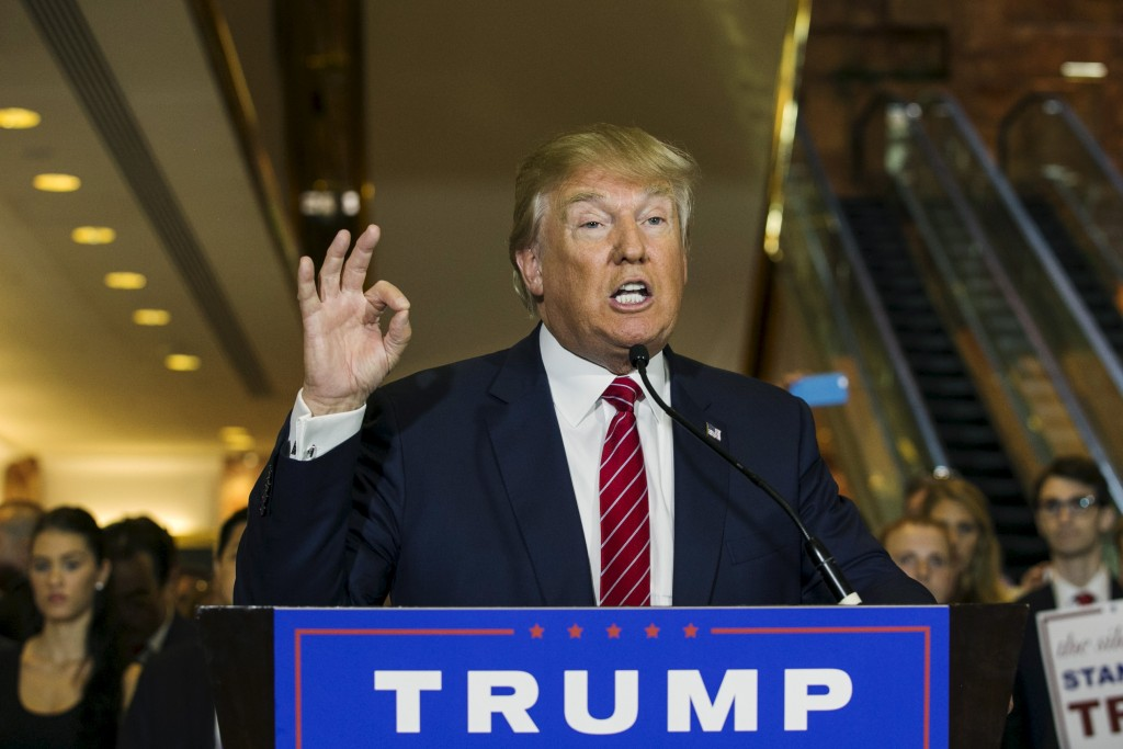 U.S. presidential hopeful Donald Trump holds up a signed pledge during a press availability at Trump Tower in Manhattan, New York September 3, 2015. The pledge is an agreement with the RNC to not to run as an independent candidate if he loses the Republican Party nomination, a party official said, despite Trump's earlier refusals to rule out a third-party bid.  REUTERS/Lucas Jackson  - RTX1QZ9H