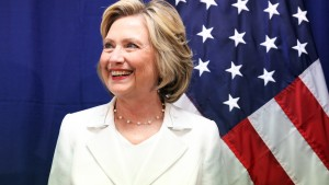 U.S. Democratic presidential candidate Hillary Clinton smiles before holding a roundtable on healthcare in San Juan, Puerto Rico, September 4, 2015. Clinton is campaigning in Puerto Rico the same day that Republican contender Marco Rubio is visiting. While Puerto Rico's residents will not be eligible to cast presidential votes in November 2016, they have a voice in the primaries and, as the island's economy has suffered, an increasing number have moved to U.S. states where they can vote, particularly Florida.  REUTERS/Alvin Baez    - RTX1R6G4