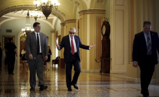 U.S. Senate Minority Leader Harry Reid (D-NV) (C) walks to his office as he arrives at the U.S. Capitol in Washington September 8, 2015. Reid, the Democratic leader in the U.S. Senate, issued a ringing defense of the Iran nuclear deal on Tuesday, saying the agreement would survive the high stakes review by Congress.  REUTERS/Jonathan Ernst - RTX1RNSH
